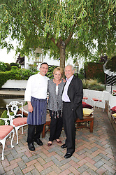 Left to right, ALAIN ROUX, ROBYN ROUX and MICHEL ROUX at a party to celebrate The Waterside Inn's 25 years as a 3 star Michelin restaurant held at The Waterside Inn, Bray, Berkshire on 18th May 2010.