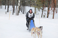 Photo Randy Vanderveen.Grande Prairie , Alberta.13-01-05.Ken Bernard urges his dog team through the race course as he takes part in the Four Dog -4 Mile event. The Grande Prairie Sled Dog Derby ran two days of races at Evergreen Park this past weekend, Jan. 5 and 6.
