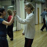 Same-sex ballroom dancers Denae Wagner, center right, and Kate Hurley, of California, practice their standard dance routines at Stepping Out Studios in Manhattan on May 3, 2007, in preparation for the 5 Boro Dance Challenge...The locally produced 5 Boro Dance Challenge, New York City's first major same-sex dance competition, was held at the Park Central Hotel in Manhattan from May 4-6, 2007.  ..The women train at The Ballroom of Sacramento. ..They are listening to their music on an iPOD with a headphone splitter. ....