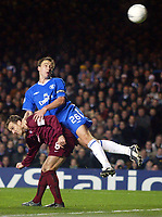 Photograph: Scott Heavey.<br />Chelsea v Sparta Prague. Group G Champions League. 26/11/2003.<br />John Terry rises above Karel Poborsky, but his header sails just wide