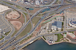 """Pearl Harbor Memorial """"Q"""" Bridge, East Bound Approaches just west of Bridge. I95 I91 Route 34 Interchange Aerial Photograph. Showing Water Street left-right top, Long Wharf Drive bottom, and Brewery Street left."""
