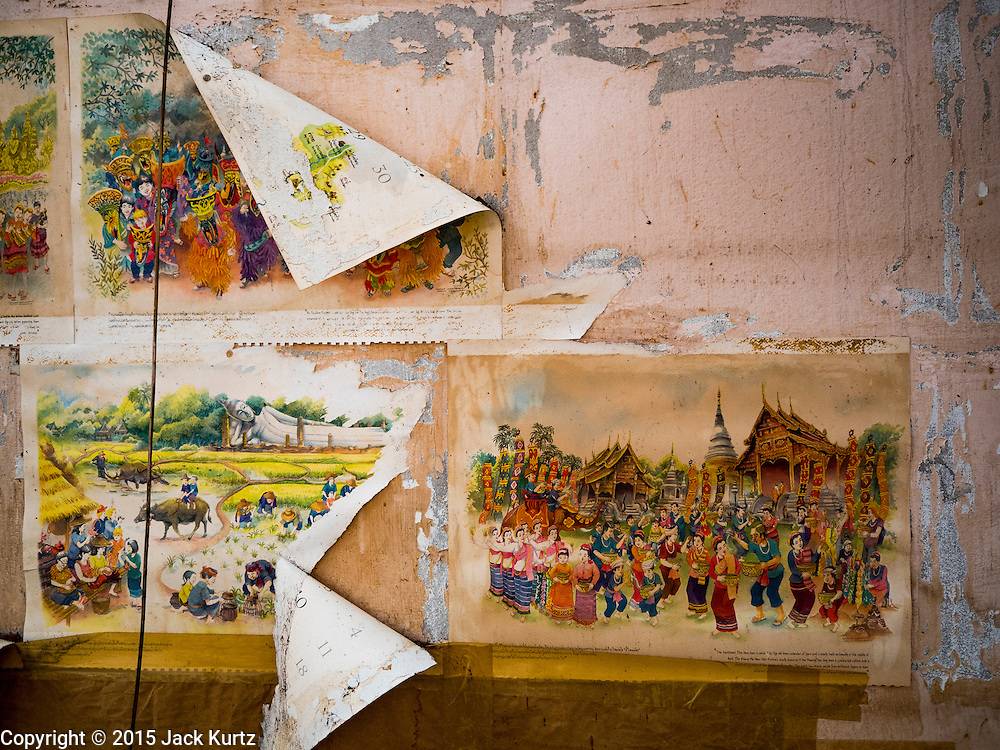28 SEPTEMBER 2015 - BANGKOK, THAILAND:  A child's art on the wall of destroyed home in the Wat Kalayanamit neighborhood. Fifty-four homes around Wat Kalayanamit, a historic Buddhist temple on the Chao Phraya River in the Thonburi section of Bangkok, are being razed and the residents evicted to make way for new development at the temple. The abbot of the temple said he was evicting the residents, who have lived on the temple grounds for generations, because their homes are unsafe and because he wants to improve the temple grounds. The evictions are a part of a Bangkok trend, especially along the Chao Phraya River and BTS light rail lines. Low income people are being evicted from their long time homes to make way for urban renewal.   PHOTO BY JACK KURTZ