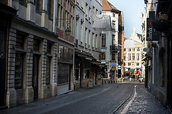 """© Licensed to London News Pictures. 23/11/2015. Brussels, Belgium. A deserted street at 2pm in central Brussels where the city is currently on """"lockdown"""" amid """"imminent threat"""" of Paris-style bomb and gun attacks. Photo credit: Ben Cawthra/LNP"""