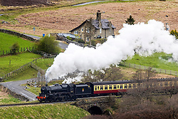 """© Licensed to London News Pictures. 18/05/2021. Goathland UK. 1945 LMS Stanier Class Locomotive 44871 """"Black Five"""" on route from Whitby to Pickering on the North Yorkshire Moors Railway this morning. The NYMR has started running its trains again this week as Lockdown measures are lifted. Photo credit: Andrew McCaren/LNP"""
