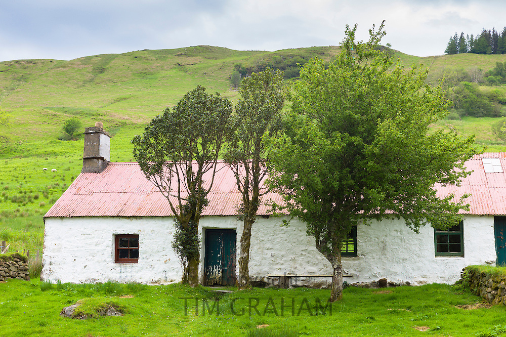 Quaint cottage dwelling with corrugated iron roof at Auchindrain highland farming township settlement and village folklore museum at Furnace,  near Inveraray in the Highlands of Scotland