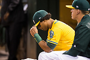 Oakland Athletics designated hitter Khris Davis (2) reacts to game play against the Los Angeles Angels at Oakland Coliseum in Oakland, California, on September 5, 2017. (Stan Olszewski/Special to S.F. Examiner)