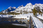 The Tetons in winter above Cottonwood Creek bridge, Grand Teton National Park, Wyoming USA