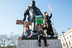 London, UK. 15th February, 2019. Students around the Winston Churchill statue in Parliament Square during the YouthStrike4Climate for Climate Day which was attended by thousands of young people. Streets around Westminster were later blocked by a mixture of sit-down and moving protests for around an hour. Strike events involving schools all over the UK were organised by UK Student Climate Network and the UK Youth Climate Coalition to demand that the Government declare a climate emergency and take positive steps to address the climate crisis, including highlighting the issue as part of the school curriculum, as well as lowering the voting age to 16.