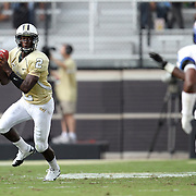 Central Florida quarterback Jeff Godfrey (2) scrambles during an NCAA football game between the Memphis Tigers and the Central Florida Knights at Bright House Networks Stadium on Saturday, October 29, 2011 in Orlando, Florida. (AP Photo/Alex Menendez)