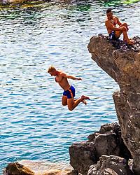 Cliff jumper at the habor in Manarola, Cinque Terre, Italy