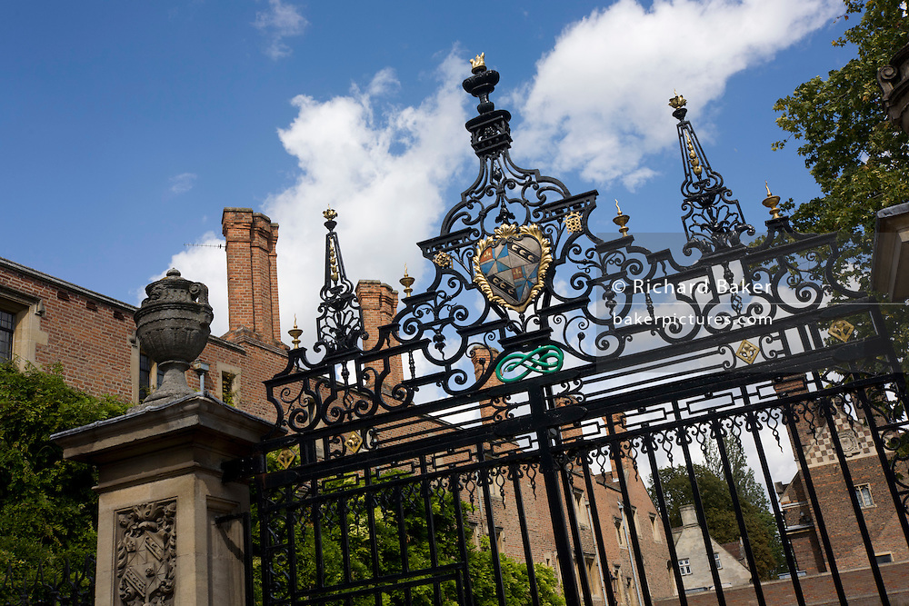 Looking up at the tall wrought iron gates of Magdalene College, a constituent college of the University of Cambridge, England
