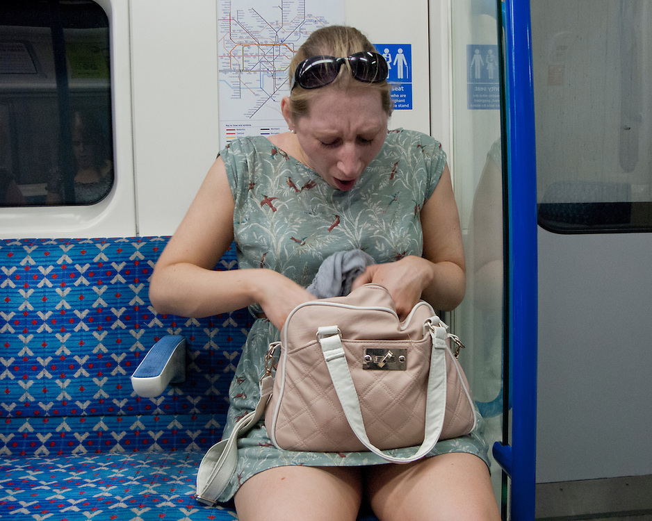 Woman on the London Underground network looking through her bag