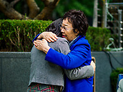 """10 OCTOBER 2018 - SEOUL, SOUTH KOREA: LEE YONG-SOO, one of the few surviving """"comfort women"""" comforts a South Korean student who spoke during the Wednesday Demonstration to protest Japan's sexual enslavement of Korean women during World War II. Lee has said she was tortured with electic shock and raped by Japanese soldiers four to five times a day during her enslavement. The Wednesday protests have been taking place since January 1992. Protesters want the Japanese government to apologize for the forced sexual enslavement of up to 400,000 Asian women during World War II. The women, euphemistically called """"Comfort Women"""" were drawn from territories Japan conquered during the war and many came from Korea, which was a Japanese colony in the years before and during the war. The """"comfort women"""" issue is still a source of anger of many people in northeast Asian areas like South Korea, Manchuria and some parts of China.        PHOTO BY JACK KURTZ   <br /> Wednesday Demonstration demanding Japan to redress the Comfort Women problems"""