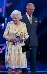 Queen Elizabeth II and the Prince of Wales on stage at the Royal Albert Hall in London during a star-studded concert to celebrate her 92nd birthday.