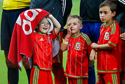 A young Wales mascot cheekily hides from the rain underneath a towel during the Welsh Anthem - Photo mandatory by-line: Rogan Thomson/JMP - 07966 386802 - 12/06/2015 - SPORT - FOOTBALL - Cardiff, Wales - Cardiff City Stadium - Wales v Belgium - EURO 2016 Qualifier.