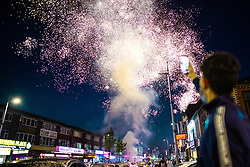 © Licensed to London News Pictures. 20/07/2021. Manchester, UK. Fireworks are set off from the road . Muslims celebrate Eid al-Adha in Rusholme in Manchester. The festival marks the Islamic tale of the prophet Ibrahim , who offered his son as a sacrifice to Allah . Photo credit: Joel Goodman/LNP
