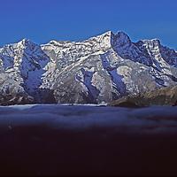 Fog floats in Nepal's Khumbu Valley, below [Mount] Kwange Ri and other Himalayan peaks.