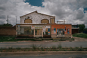 """Bullet holes riddle a house and grocery store in Juan Aldama, in Zacatecas after an attack. In northern Zacatecas, a faction of the Sinaloa cartel led by Ismael """"El Mayo"""" Zambada has moved in. Gunmen in pickups have been seen cruising freely through the area, """"MZ"""" emblazoned on their helmets or guns."""