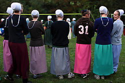 Young Amish girls play volleyball during the Charm Days Festival in Charm, Ohio, Oct. 10, 2009.