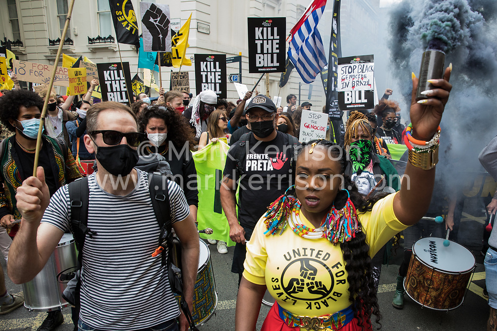 Marvina Newton, founder of United for Black Lives, holds aloft a smoke grenade during a Kill The Bill National Day of Action in protest against the Police, Crime, Sentencing and Courts (PCSC) Bill 2021 on 29th May 2021 in London, United Kingdom. The PCSC Bill would grant the police a range of new discretionary powers to shut down protests, including the ability to impose conditions on any protest deemed to be disruptive to the local community, wider stop and search powers and sentences of up to 10 years in prison for damaging memorials.