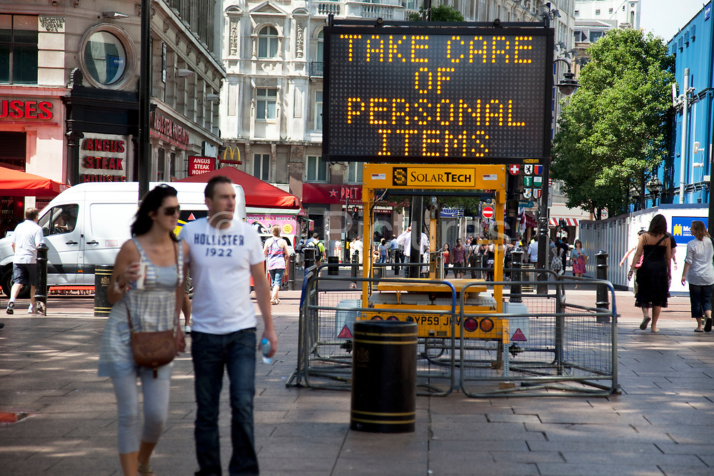 Public announcement / warning sign in Leicester Square, a hugely popular area for tourism in the West End, London. The words say 'take care of personal items' urging people to take care and be vigilant against crime.