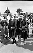 Funeral of Eamon DeValera.   (J72)..1975..02.09.1975..09.02.1975..2nd September 1975..Today saw the funeral of Eamon DeValera. He was laid to rest beside his wife Sinead in Glasnevin Cemetery,Dublin. Dignitries from all around the world attended at the funeral..Members of acedemia leave the cemetery after the funeral.