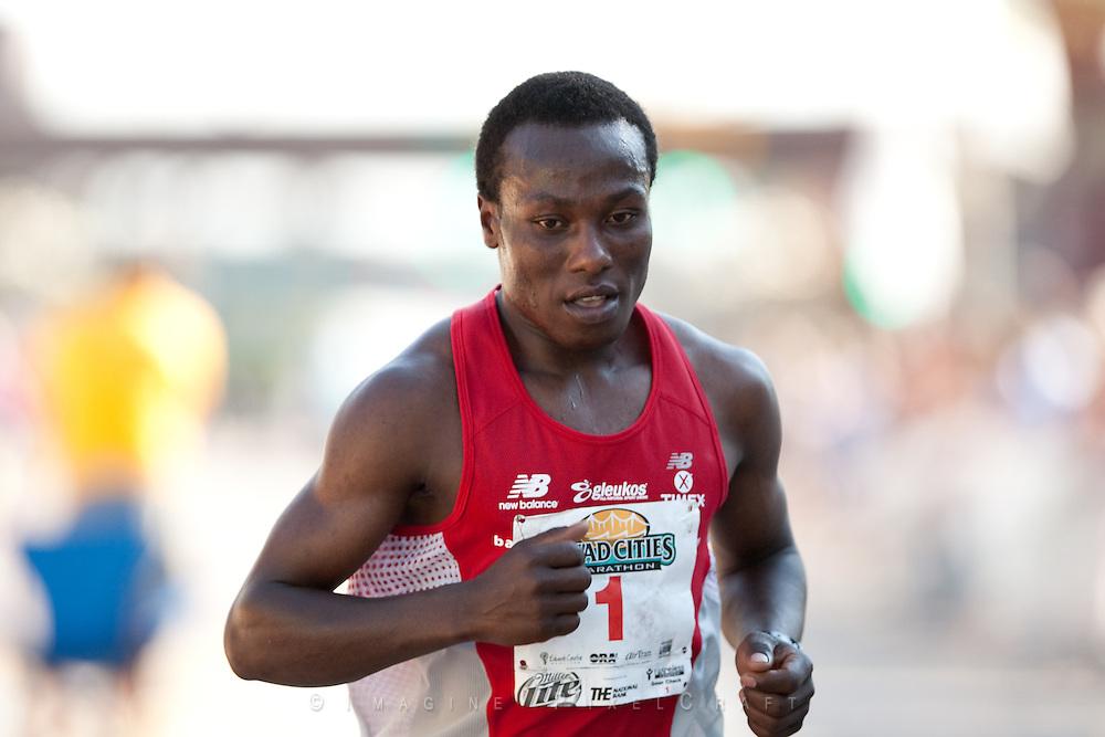 The 2008 marathon winner, Jynocel Basweti crosses the finish line of the 2009 Quad Cities Marathon in second place.