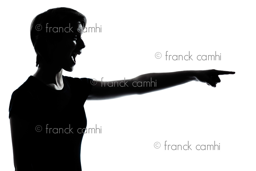 one caucasian young teenager silhouette  girl pointing laughing  portrait in studio cut out isolated on white background