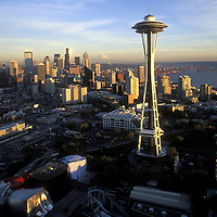 USA, Washington, Seattle, Aerial view of Space Needle and downtown skyline with Mount Rainier is distance at sunset