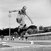A senior long jumper competes in the 80-84-year-old age division at the 2007 World Masters Championships Stadia (track and field competition) at Riccione Stadium in Riccione, Italy on September 6, 2007. ..9,000 male and female athletes over the age of 35 from 90 countries competed in two weeks of track and field events at the 17th annual event. The event is run by  the World Association of Masters Athletes, the organization designated by the IAAF (The International Association of Athletics Federations) to conduct the worldwide sport of masters athletics. The organization runs competitions and maintains record standings in the 5-year increment age divisions.  ...