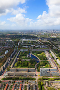 Nederland, Zuid-Holland, Leidschendam, 09-05-2013; De Prinsenhof, nieuwbouwwijk uit de jaren zestig, overloopgebied voor Den Haag. Foto richting wijk De Heuvel, skyline Den Haag in de achtergrond. Basiontwerp is rechthoekig hof bestaande uit dubbele ring van woningen (middelhoogbouw) met daarbinnen voorzieningen in het groen. Wederopbouwgebied.<br /> New residential area built in the sixties, overflow area for The Hague. Basic design is rectangular court with a double ring of housing (medium-rise) and green courtyard in the middle. Reconstruction area. Skyline The Hague in the back.<br /> luchtfoto (toeslag op standard tarieven)<br /> aerial photo (additional fee required)<br /> copyright foto/photo Siebe Swart