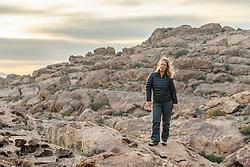 Sarah Hepola on rock ledge, Hueco Tanks State Park & Historic Site, El Paso, Texas. USA.