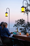 Diners enjoy wine and the sunset over the Big Sur coastline, at Nepenthe