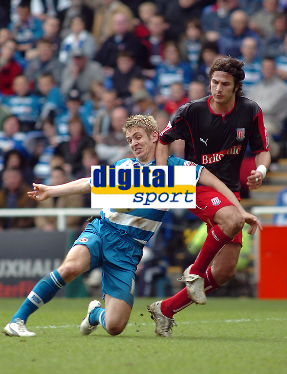 Photo: Kevin Poolman.<br />Reading v Stoke City. Coca Cola Championship. 17/04/2006. Reading's Kevin Doyle is pulled down by Stoke's Carl Hoefkens which gave Reading their penalty.