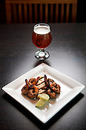 1 OCT. 2015 -- MARYLAND HEIGHTS, Mo. -- A featured item on the menu at O'Bar, the bar and restaurant at the O'Fallon Brewery's Maryland Heights facility, is the Beer Lime Shrimp appetizer, which includes grilled large shrimp marinated in 5-Day IPA, soy, and lime, photographed at the restaurant Thursday, Oct. 1, 2015.  It is shown with a glass of O'Fallon 5-Day IPA. Photo © copyright 2015 Sid Hastings.
