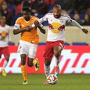 Thierry Henry, (right), New York Red Bulls, shakes off the challenge of Warren Creavalle, Houston Dynamo, during the New York Red Bulls V Houston Dynamo, Major League Soccer regular season match at Red Bull Arena, Harrison, New Jersey. USA. 23rd April 2014. Photo Tim Clayton