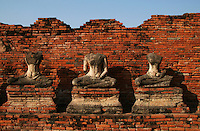 Headless Buddhas at Wat Chaiwattanararam - Wat Chaiwattanaram silhouette at sunset - one of Ayutthaya's most beautiful temples - construction began in 1630 at the request of King Prasat Thong for the memorial of his mother. The temple's name literally means the Temple of Long Reign and Glorious Era.
