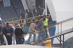 Refugees and migrants, escorted by the European border control agency Frontex personnel, board a vessel at Mytilene port in Greece, on April 8, 2016. A total of 124 refugees and migrants were returned to Turkey from Greek islands on Friday, the second of such mission in a week under the EU-Turkey deal to cope with the refugee crisis. EXPA Pictures © 2016, PhotoCredit: EXPA/ Photoshot/ Anthi Pazianou<br /> <br /> *****ATTENTION - for AUT, SLO, CRO, SRB, BIH, MAZ, SUI only*****