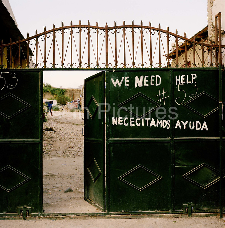 "All around Port Au prince are the hand painted signs and banners shown in the pictures, such was the desperation shortly after the earth quake. Many went without food and water for several days or more. The tragedy is that  it seems many of these requests went largely ignored. Theo , like many haitians is bemused ""We painted a sign saying we needed food and water in the hope that the aid agencies may be able to help, but no one has helped, not one person."""