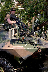 05 Sept  2005. New Orleans, Louisiana. Post hurricane Katrina.<br /> The US military patrol the streets in Uptown New Orleans on Napolean Ave in amphibious vehicles, heavily armed but also capable of collecting the last remaining people stranded by the storm.<br /> Photo; ©Charlie Varley/varleypix.com
