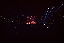 Yes Band performing In The Round at the New Haven Coliseum, New Haven Connecticut, on 4 September 1978. Wide view of Coliseum Interior as Concert Ends. Fan Lighters and Matches Fill The Air.
