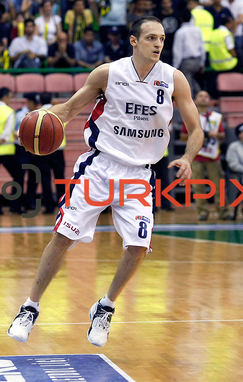 Efes Pilsen's Igor RAKOCEVIC during their Turkish Basketball league Play Off Final fifth leg match Efes Pilsen between Fenerbahce Ulker at the Ayhan Sahenk Arena in Istanbul Turkey on Sunday 30 May 2010. Photo by Aykut AKICI/TURKPIX