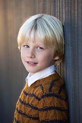 portrait of a 7 year old blond boy with blue eyes