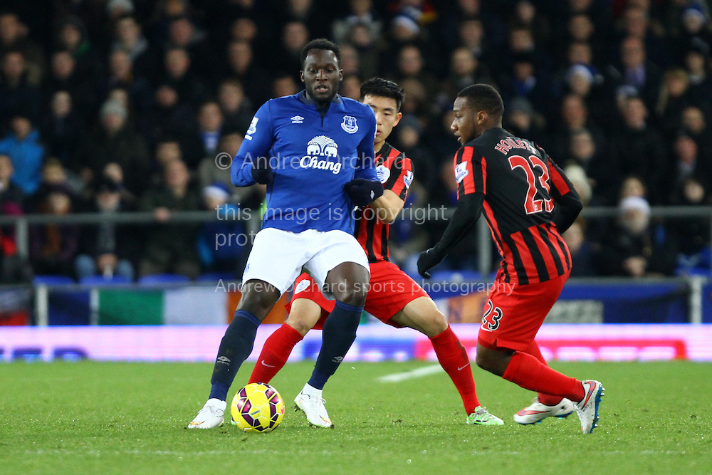 Romelu Lukaku of Everton shields the ball. Barclays Premier league match, Everton v Queens Park Rangers at Goodison Park in Liverpool, Merseyside on Monday 15th December 2014.<br /> pic by Chris Stading, Andrew Orchard sports photography.