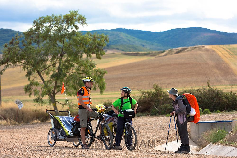 Pilgrims cycling with baby the Camino de Santiago Pilgrim's route to Santiago de Compostela in Galicia, Spain