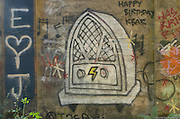 Street art painting in old mill building in Vernonia, Oregon depicts an antique radio