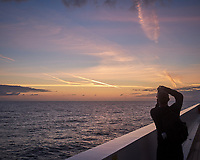 Pink Jet Contrails at Dawn over the North Atlantic Ocean from the Deck of MV Explorer. Image taken with a Leica X2 camera (ISO 200, 24 mm, f/7.1, 1/125 sec).