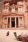 Leora Leshem photographs a camel in front of The Treasury (Al Khazneh) in Petra, Jordan.