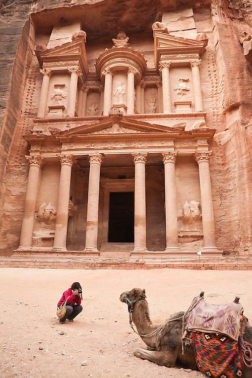 Leora Leshem photographs a camel in front of The Treasury (Al Khazneh) in Petra, Jordan.