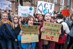 © Licensed to London News Pictures. 15/03/2019. Bristol, UK. Youth Strike 4 Climate outside Bristol City Hall on College Green. The Bristol event is part of a UK wide and international day of protest as students and school pupils across the world miss classes, striking to protest a lack of governments' action to combat the climate crisis. The international movement was started by Swedish student Greta Thunberg. Photo credit: Simon Chapman/LNP